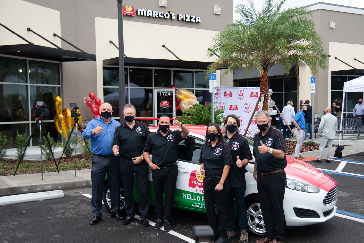 The Marco's Pizza team at the grand opening of the 1000th location.