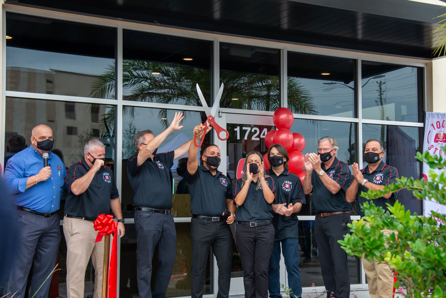 Marco's franchisees celebrate at the grand opening of the 1000th Marco's Pizza store.