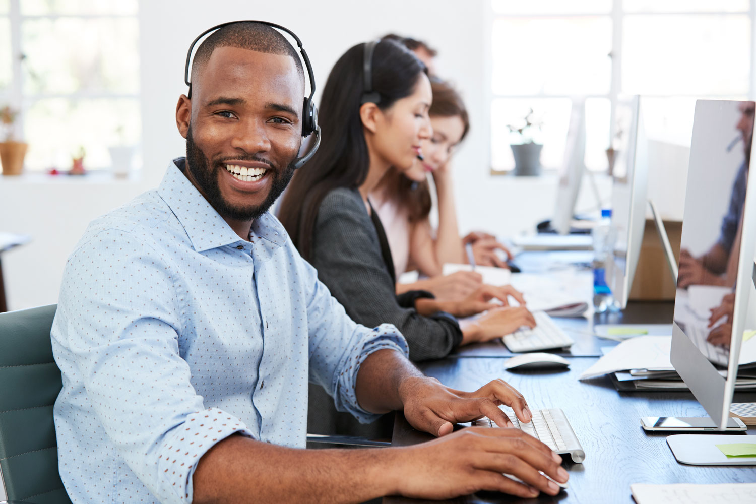 Young Customer Service Rep in Call Center